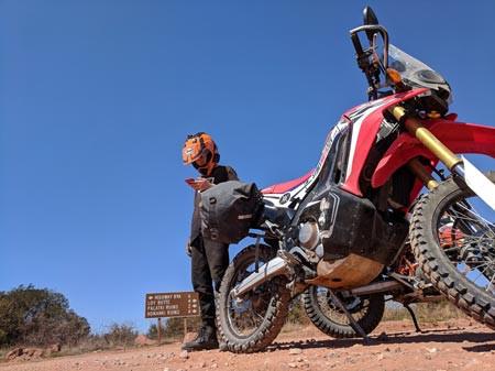 Honda CRF 250L Rally Motorcycle camping with VUZ Moto soft panniers in Sedona Arizona