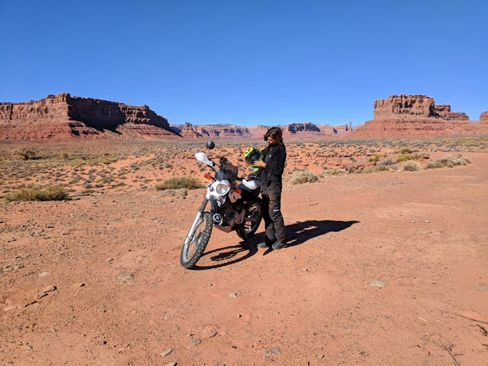 Bonnie johnson of Story Moto ADV motorcycle camping on her XT 250 in Utah