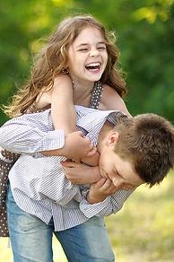 girl piggyback with boy