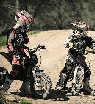 two boys on bikes and track.jpg
