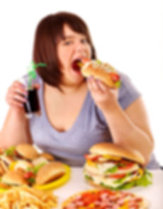 Overweight woman eating fast food..jpg