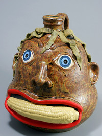 Corn Mouth Face Jug