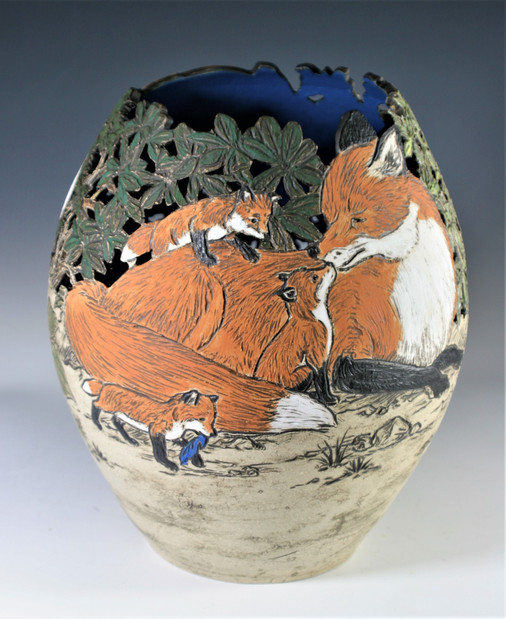 Incised and Cut-Out Vase with Foxes