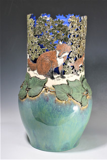 Incised and Cut-Out Fox and Grapevine Vase