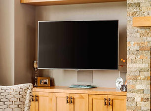 Home with Mounted TV and Surround Sound