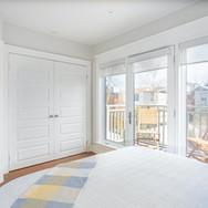 bedroom 1 with windows.jpeg