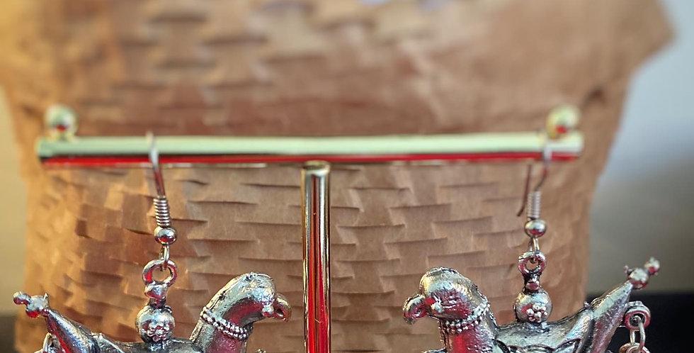 Small bird earring in German Silver