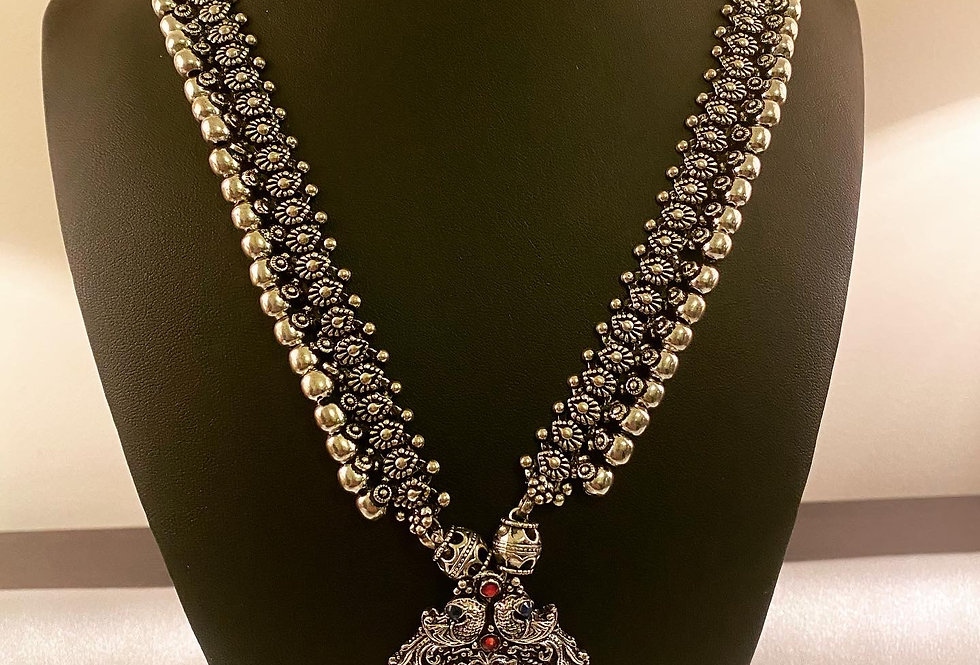 Long chain with Lakshmi pendant and Green, pink and blue stone
