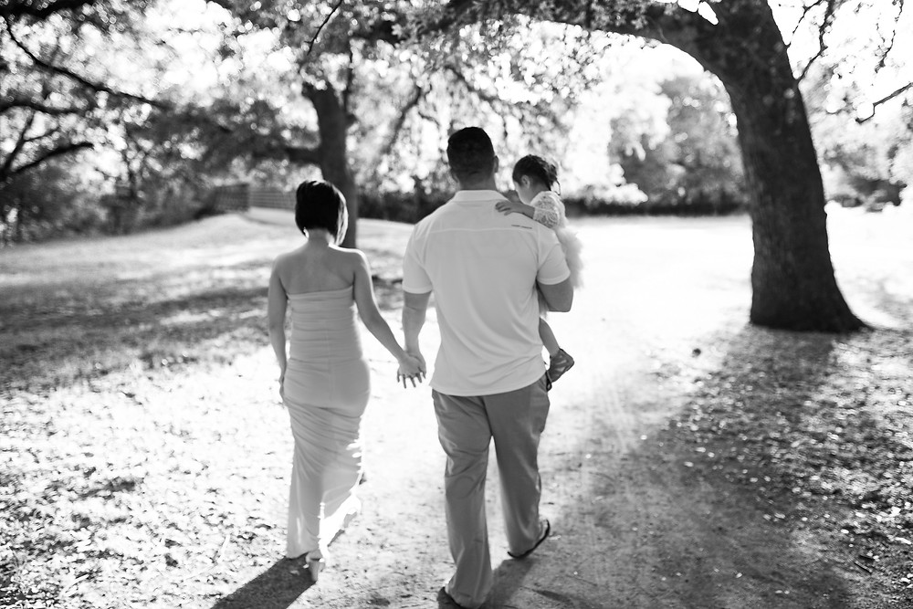 family walking from behind