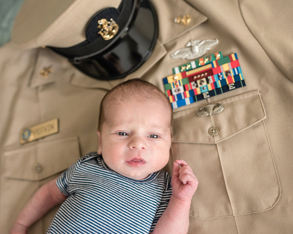 baby on navy uniform