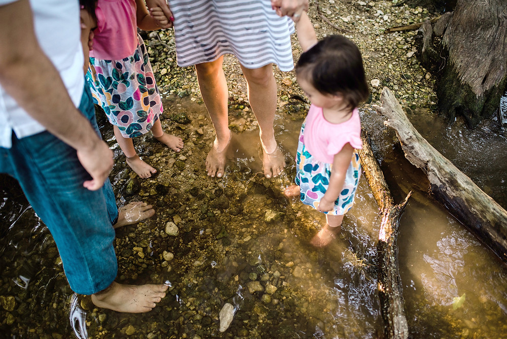 family feet in creek