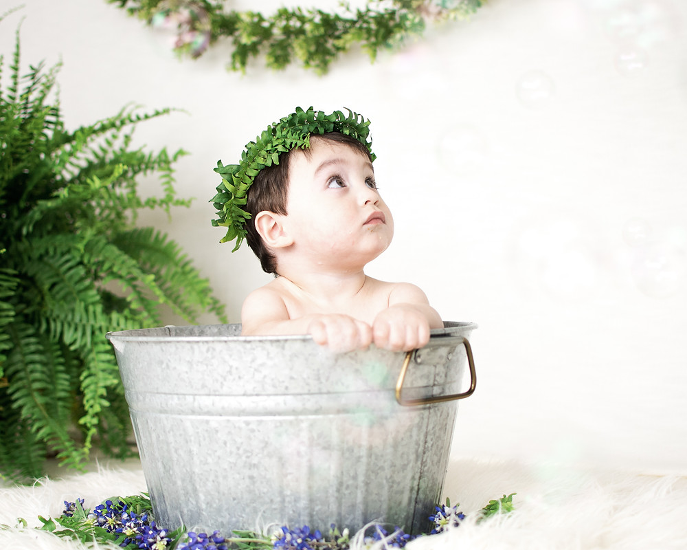 baby in basin tub