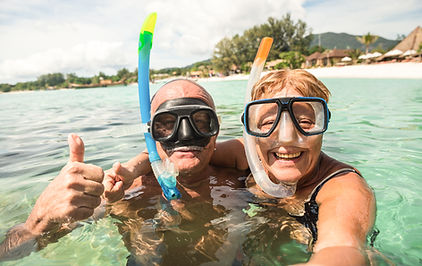 Senior happy couple taking selfie in tro
