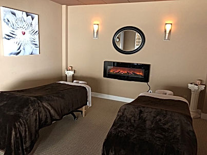 COUPLES MASSAGE ROOM WITH FIREPLACE AT BELISAMA BODYWORKS IN SARATOGA SRINGS