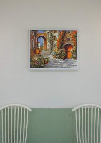 Wall Garden Lamps give off a sense of ease and the touch of canvas paintings remind us of colorful European streets.