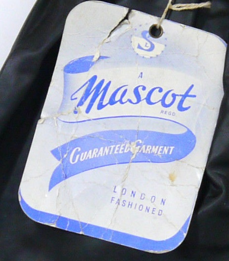 Over trousers label 1956