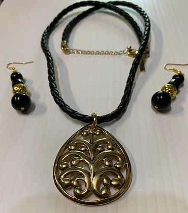 Brass medallion pendant on braided cord with matching drop earrings