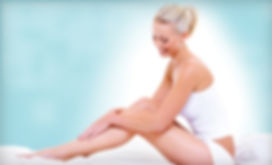 happy female stroking permanent hair free arms and legs after electrolysis