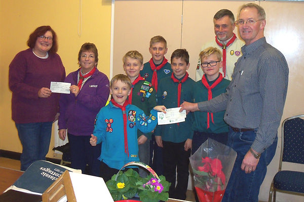 Scouts receiving their cheque