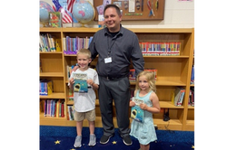 Book Presentation to the Librarian of his school - Brayden & Little Sister