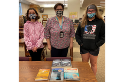 Shea G. and Reagan H. - book presentation at Mascoutah Middle School Library
