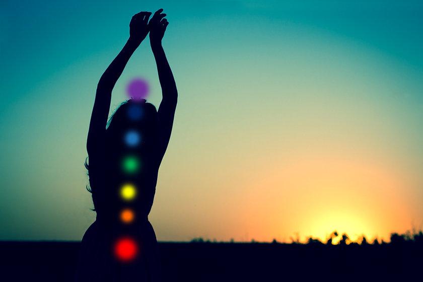Seven chakras. Silhouette of a woman aga
