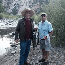 """Slade Rivers and I on the Carson River fishing, but we were really working on writing songs for the """"Honky Tonk Highway"""" album."""