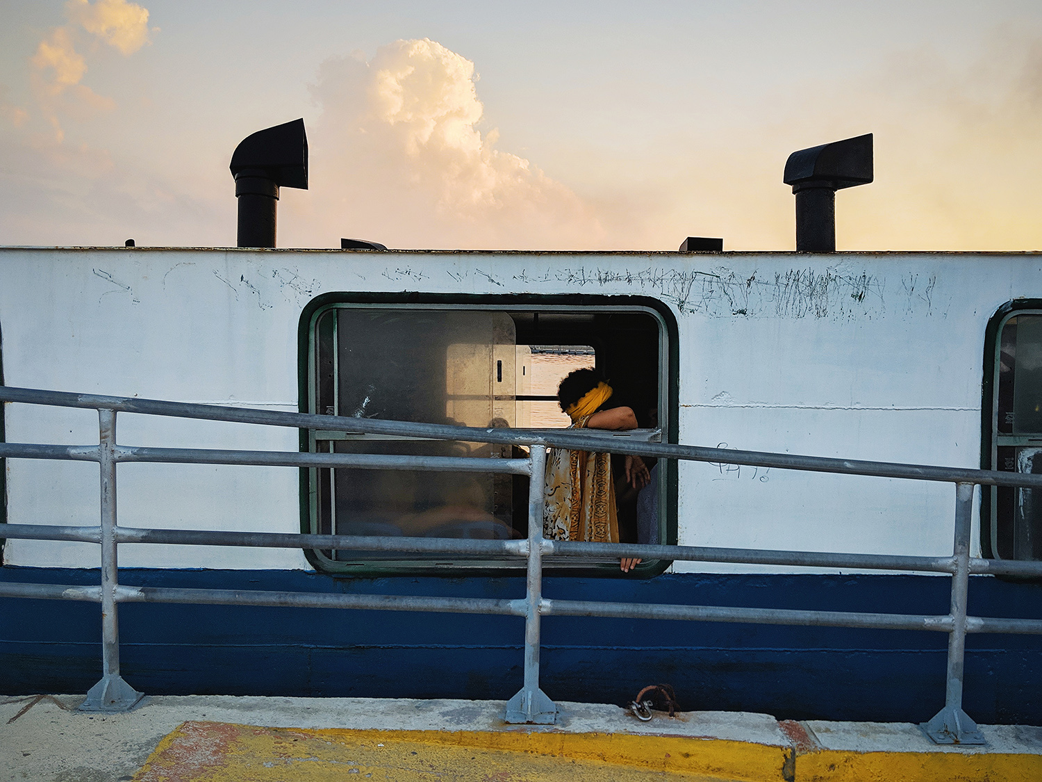 "Ralph Acosta / ""The crying woman crossing the ferry"" / Street Photography / 11x14 / $700"