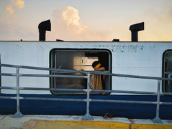 """Ralph Acosta / """"The crying woman crossing the ferry"""" / Street Photography / 11x14 / $700"""