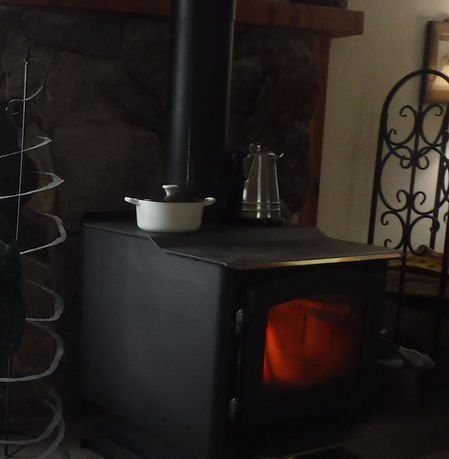 The woodburning stove heats the home a doubles as a stove.