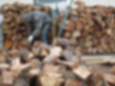 Firewood stacking, Farming Off the Grid.com
