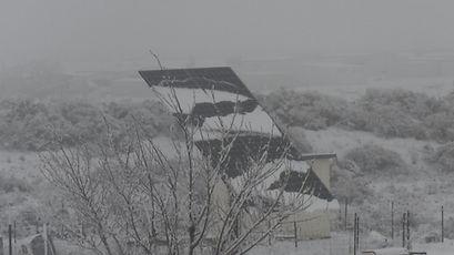 Solar panels shedding snow.