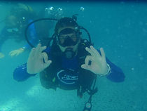 scuba diver giving ok sign