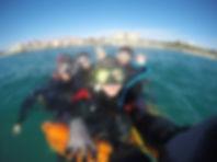 scuba divers on surface