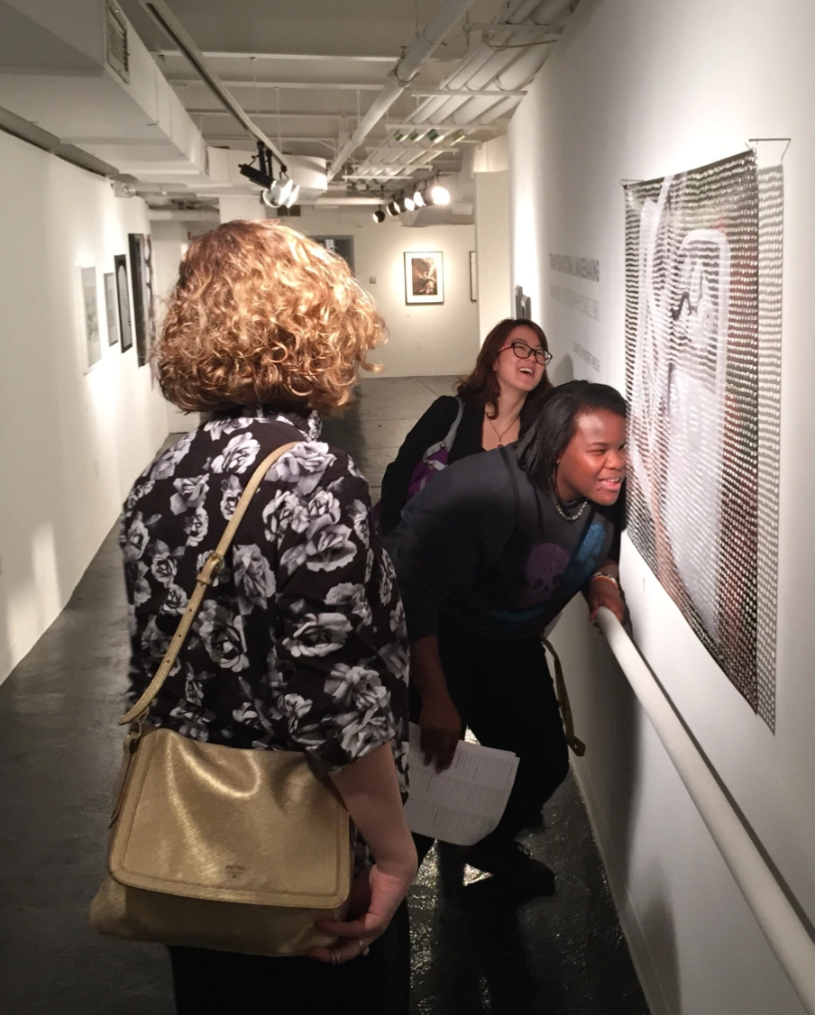 Allison Froio, Sunny Yaing and Marz Shaffore look REALLY closely at a work in the CEPA gallery. . . . .