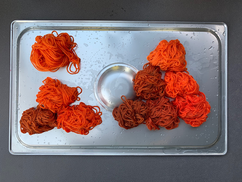 Small yarn samples in shades of orange and brown, arranged as a single sample, a triangle made of three samples, and a triangle made of six samples.