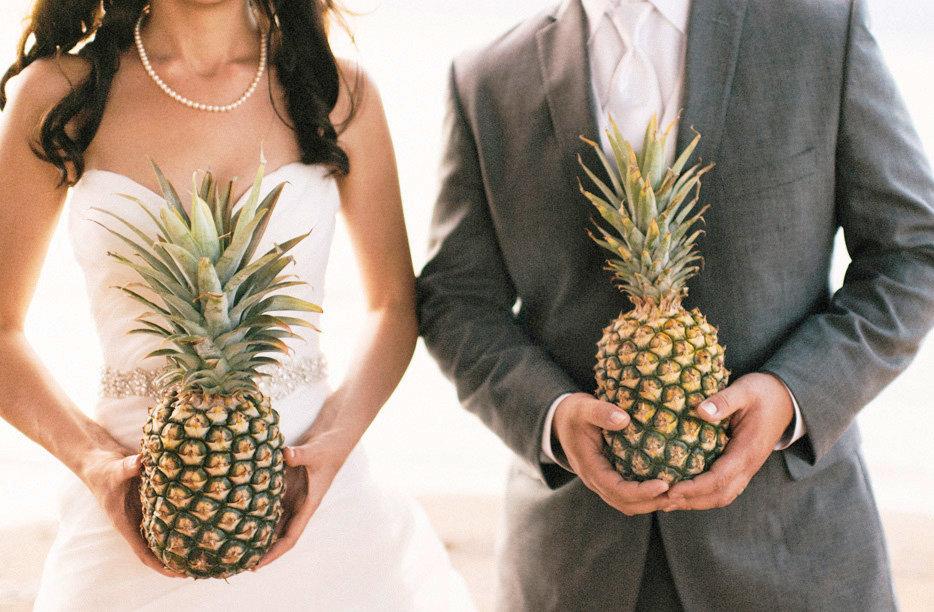 Honolulu bride holding a pineapple