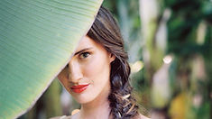 Bride with fishtail braid and red lips
