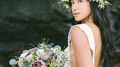 Bride with makeup and flower bouquet
