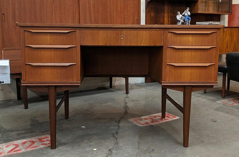 (SOLD) Curvy teak desk with raised edge