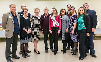 Alice in Dairyland poses with event and finale volunteers