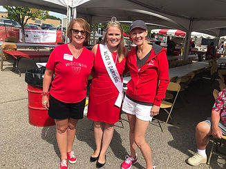 Alice in Dairyland poses with supporters at a Wisconsin Badgers football game
