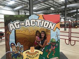 Ag in Action! Julia Nunes, the 73rd and 74th Alice in Dairyland, smiles big with a future Alice in Dairyland hopeful at the 8 Pathways to Agriculture booth at the Dane County Fair