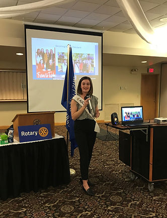 Julia Nunes, the 73rd Alice in Dairyland, speaks into a microphone