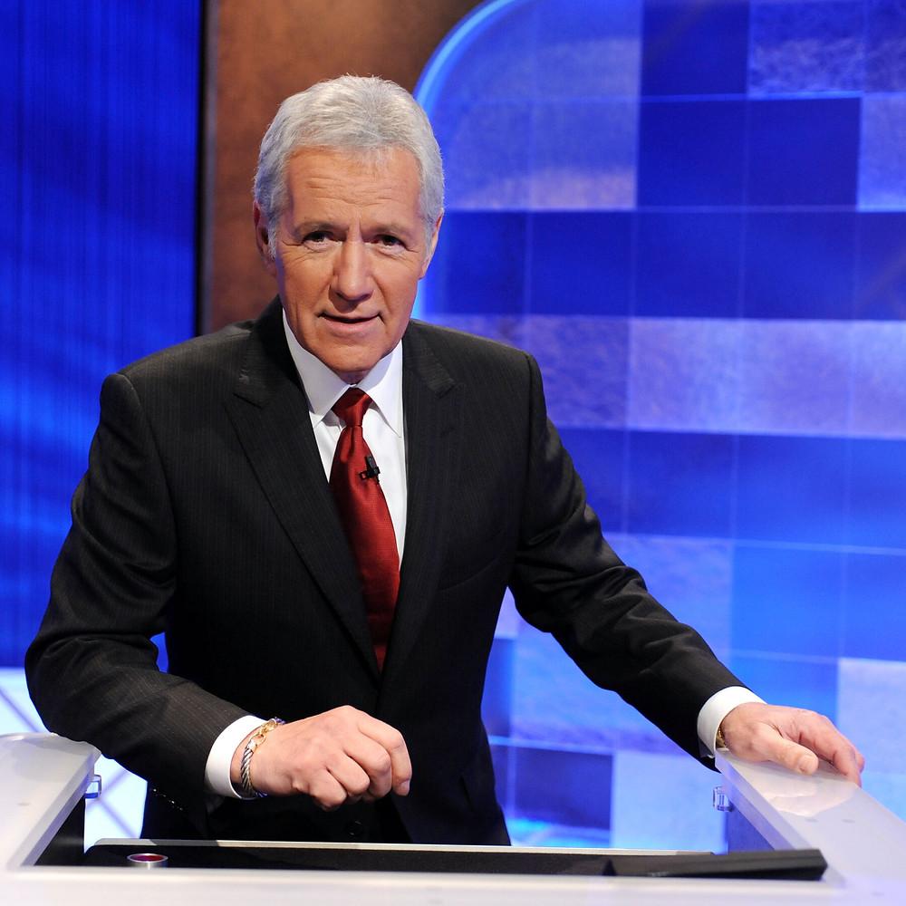 Alex Trebek the host of Jeopardy wearing a suit.