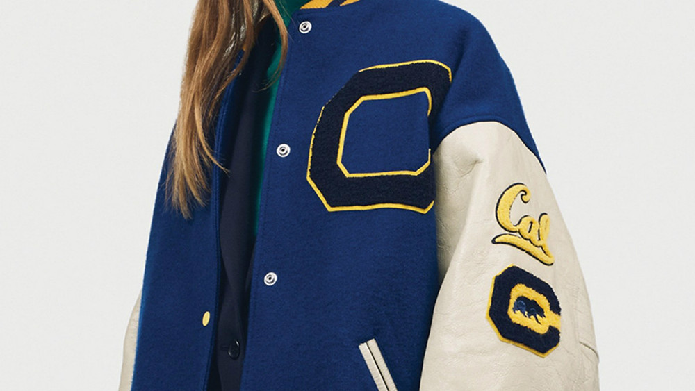 Vintage college jacket merch of UCLA and Berkley.