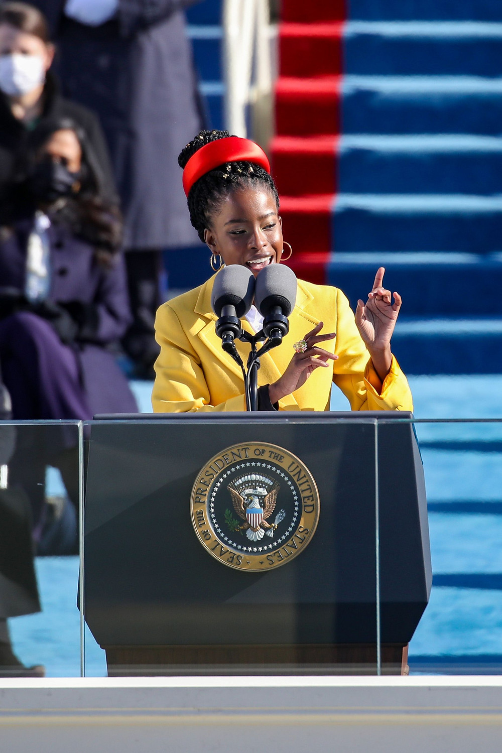 Amanda Gorman was the poet who read on Biden's Presidential Inauguration. She is the current United States Poet Laureate. In 2017, she became the United States of America's first National Youth Poet Laureate. She is also an activist from Los Angeles, California. Gorman's work focuses on issues of oppression, feminism, race, and marginalization, as well as the African diaspora