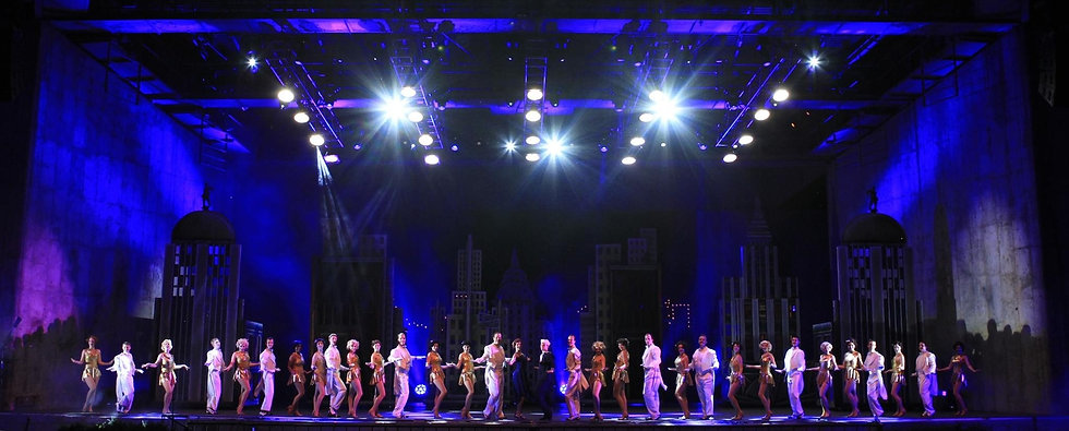 line of performers on a stage