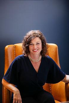 Danna Lewis headshot chair.jpg