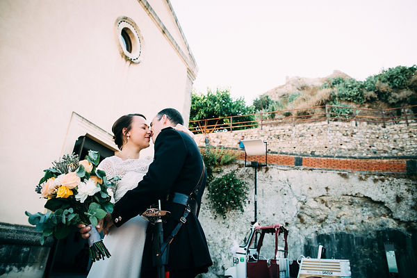 bride and grooms kissing in sicily italy savoca